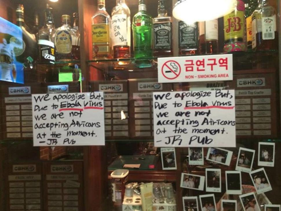 Outrage over signs barring Africans from  South Korean pub over Ebola fears