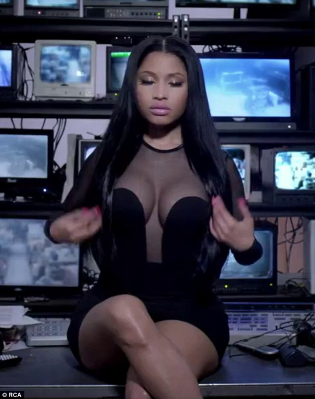 Nicki Minaj shows off her cleavage in sheer LBD in She Came To Give It To You video