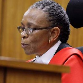 Judge Masipa reads her verdict during the trial of Olympic and Paralympic track star Pistorius at the North Gauteng High Court in Pretoria
