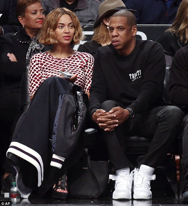 Beyonce  sitting courtside with Jay Z at the Brooklyn Nets game