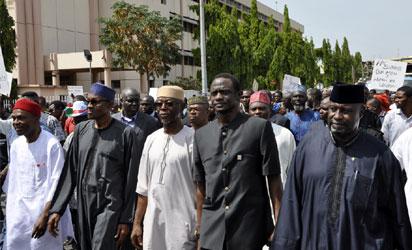 Buhari, Amaechi, others lead APC members on protest match in Abuja