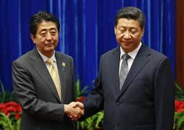 China's Xi, Japan's Abe hold landmark meeting