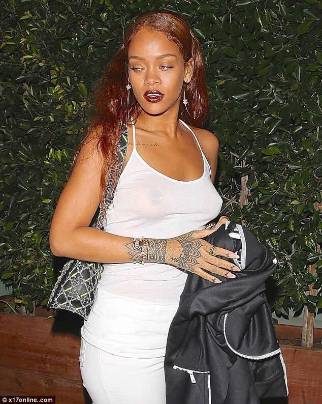 Rihanna goes braless in see-through top