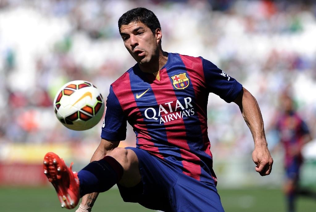 Suarez scores hat-trick in Barca's 8-0 win against Córdoba