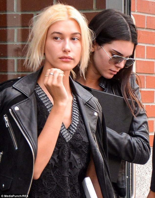 Kendall Jenner lounging in the pool with pal   Hailey Baldwin