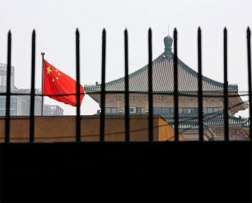 China says foreigners held over distribution of 'terrorist' materials