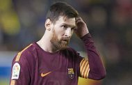 Messi fires Barcelona back to the top with dead-ball hat-trick