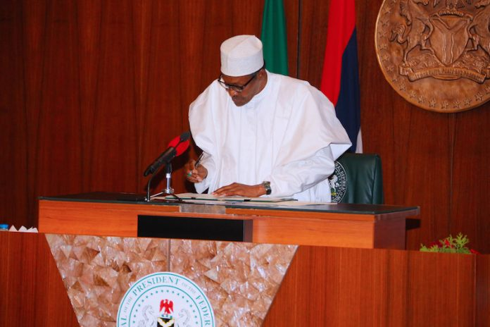 Prsident Buhari Buhari signs  Federal Competition and Consumer Protection Act