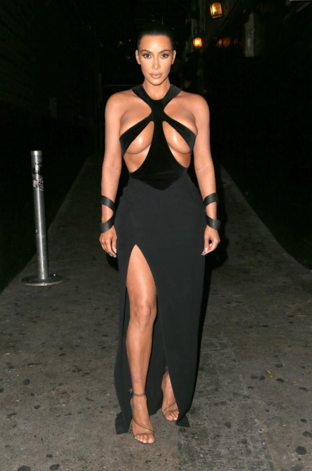 Kim Kardashian wears her most shocking dress ever as she manages to avoid a nip slip