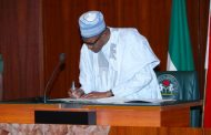 Buhari signs N30,000 Minimum Wage