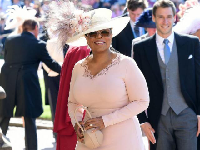 Oprah Winfrey walks one of her former students down the aisle