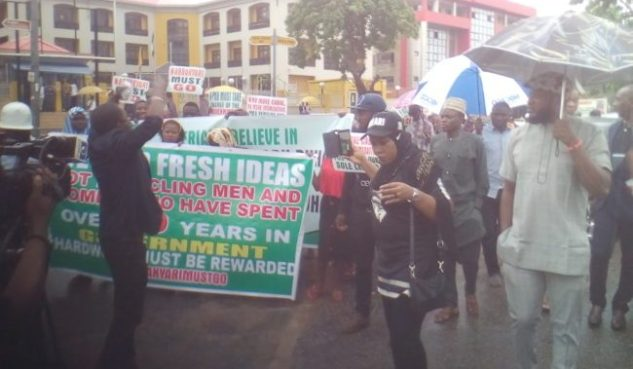 Massive protests in Abuja Nigerians over alleged hijacking of presidency by cabal