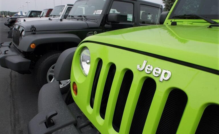 Woman arrested after being found naked in back seat of Jeep at  car dealership: Police report